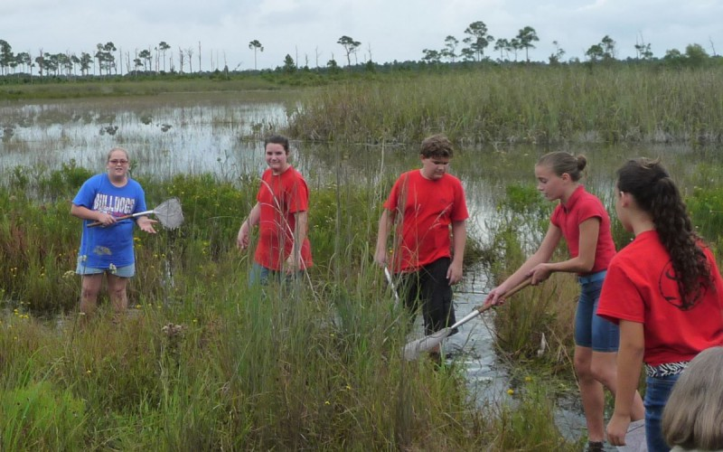 """Students explore the Savannas State Park on field trip."""